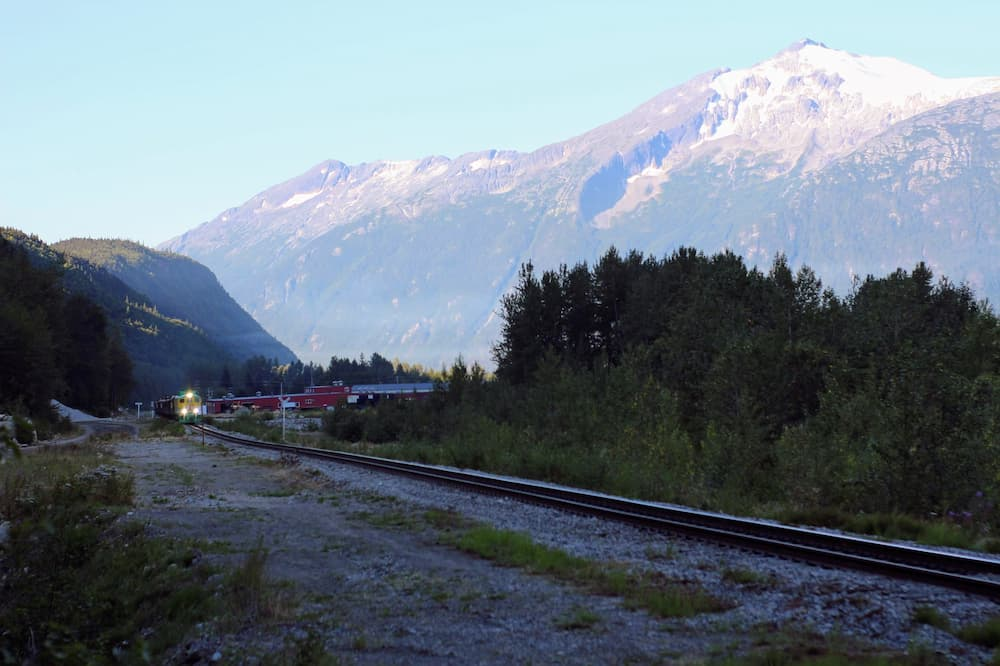 Designing Our New Life – The Power of Early Retirement - Train through the mountains of Alaska