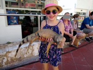 Faith holding a lizard while in Puerto Rico