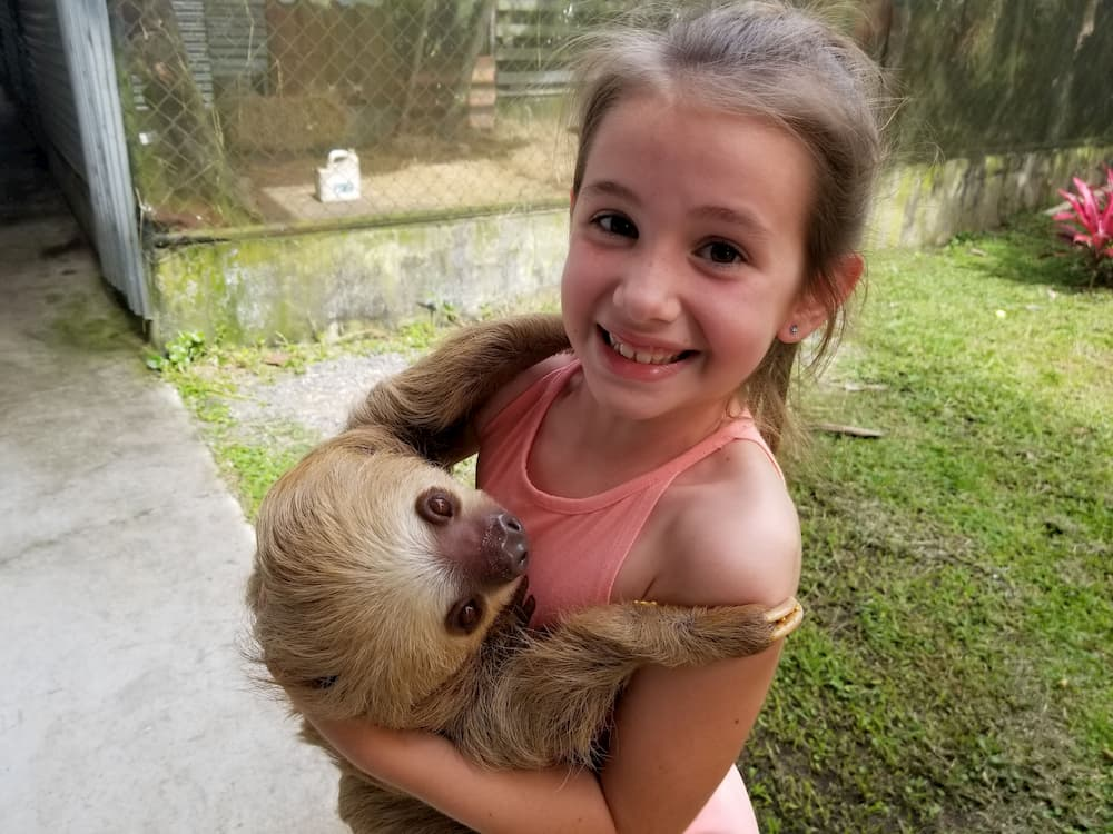 Faith Holding a Sloth