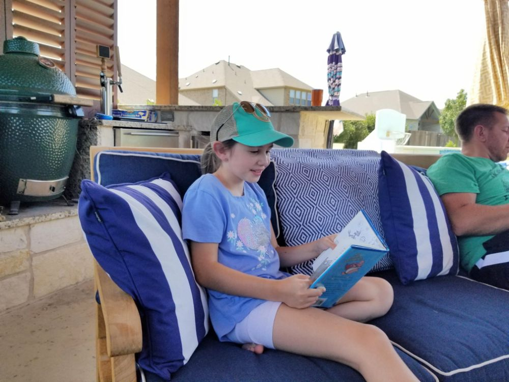 Three Weeks in Texas – A Big Stop on the Road Trip - Faith reading in the cabana