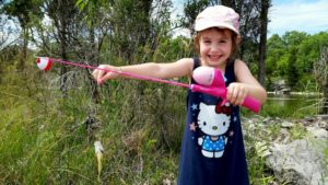 46 More Unforgettable Quotes from My Daughter [Part 2] - Faith showing a fish she caught