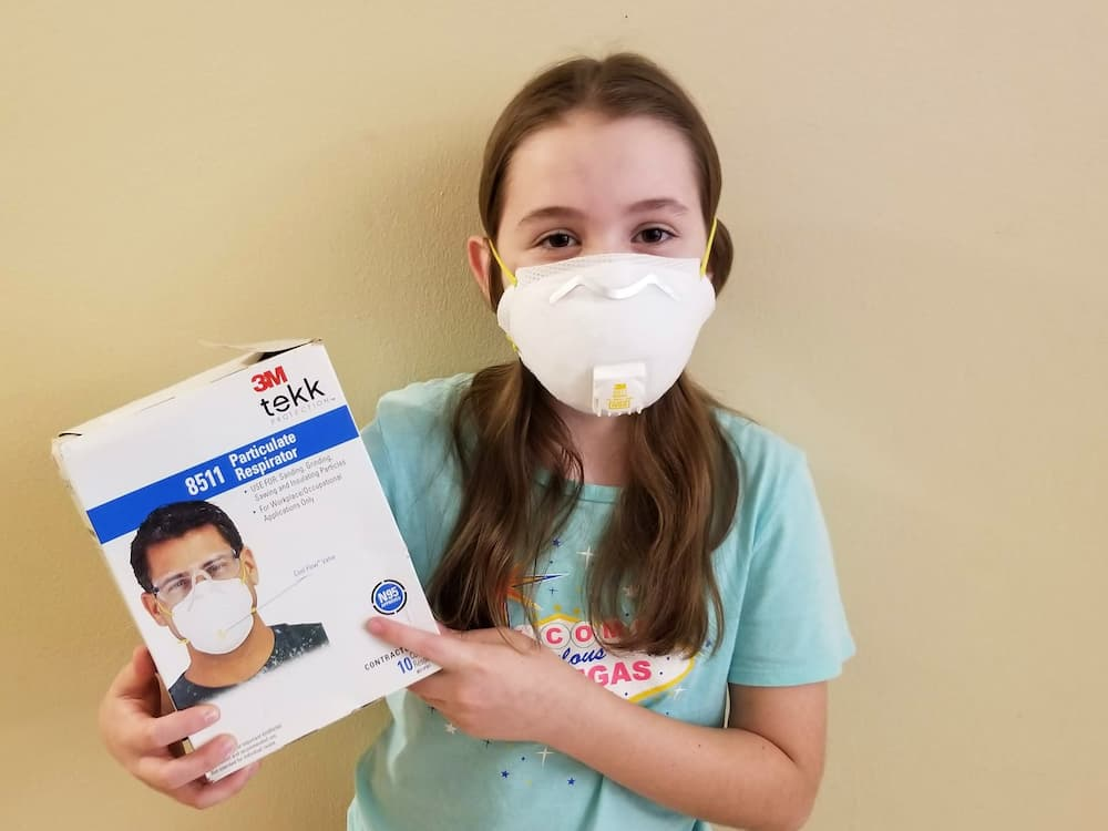 What I Did During My First Week Off in 6 Years! - Faith demonstrating our N95 mask stash