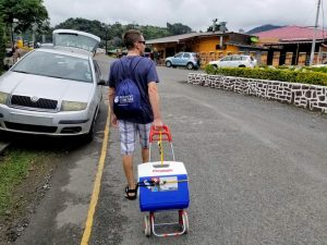 A man with his cart and cooler...