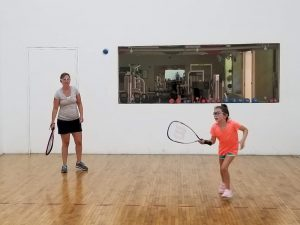 One of the Absolute Best Facets of Early Retirement - Lisa and Faith playing racquetball