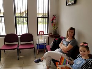 Our First Visit to the Dentist in Panama Was… Different - Lisa and Faith in the Waiting Room