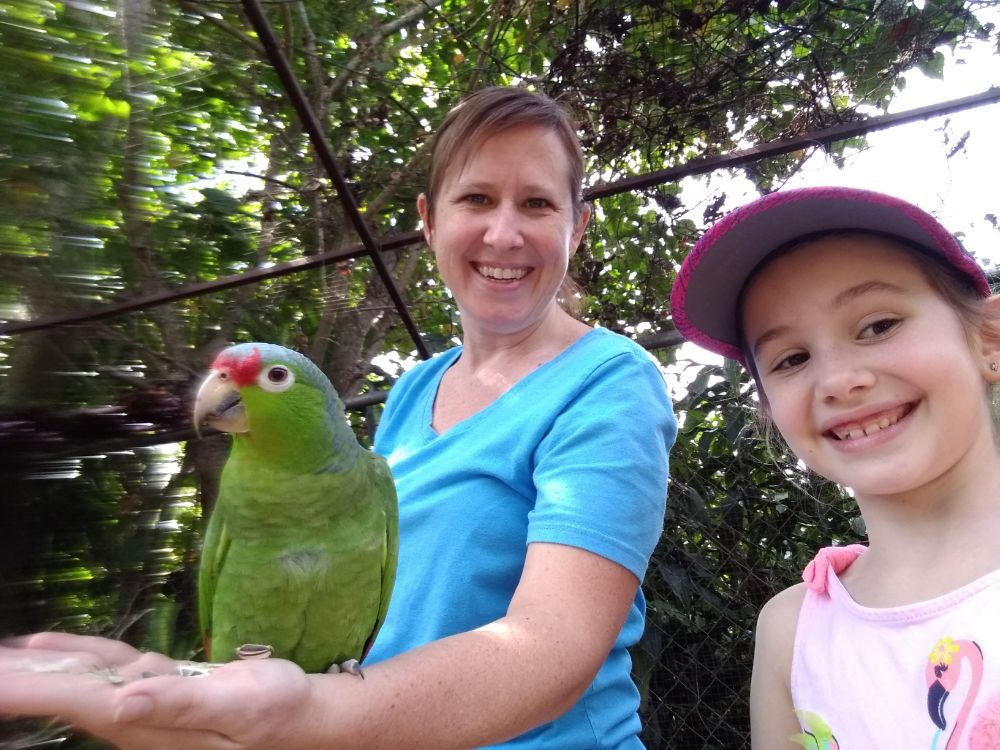 Lisa and Faith with a parrot